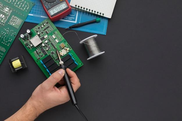 Close-up reparation of a circuit board Premium Photo