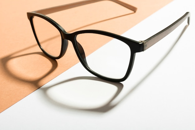 Close-up retro eyeglasses with shadow Free Photo