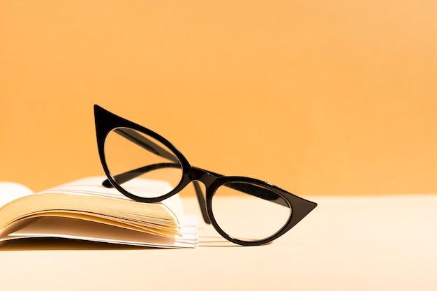 Close-up retro glasses on a book Free Photo
