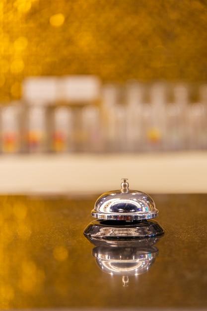 Close up of ringing reception bell. Premium Photo
