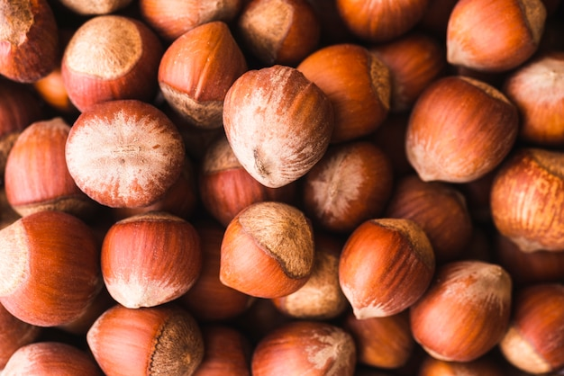 Close-up ripe chestnuts background Free Photo