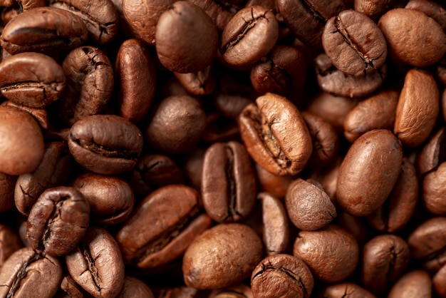 Close-up of roasted coffee beans background Free Photo