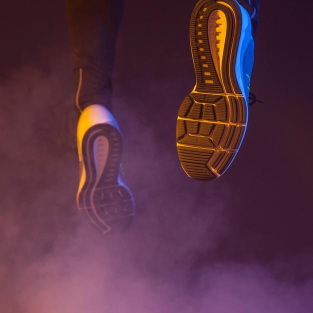 Close-up running legs Free Photo