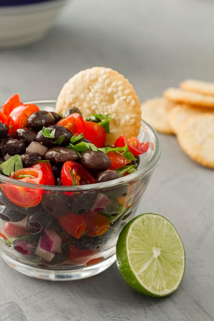Close-up salad with black beans and lime Free Photo