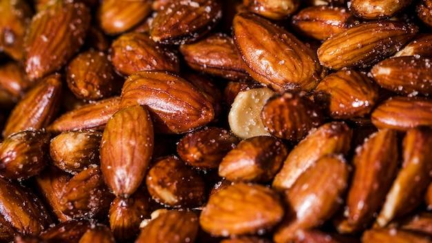 Close-up salt roasted almonds Free Photo