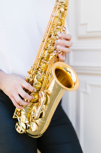 Close up saxophone being played by man Free Photo