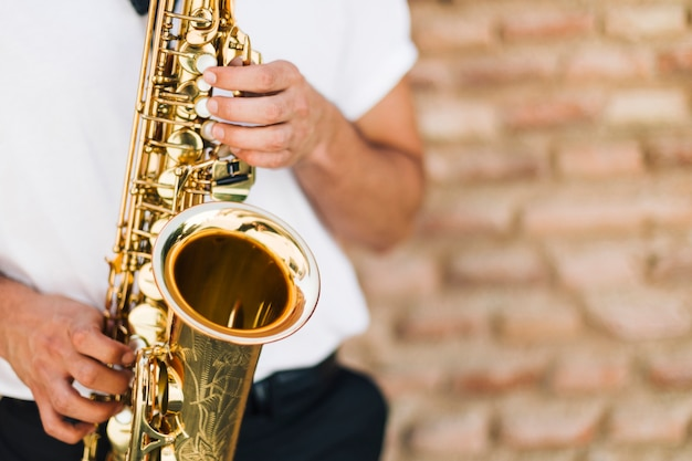 Close up saxophone played by man Free Photo