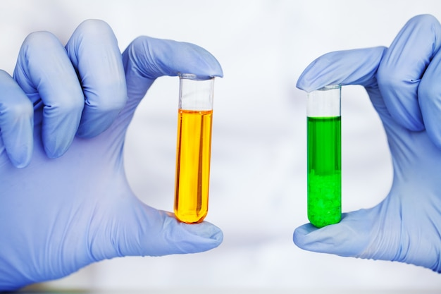 Close up of scientist checking test tubes in laboratory Premium Photo