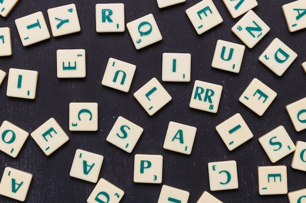 Close-up of scrabble letters against black background Free Photo