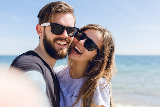Close-up self-portrait of cute couple Free Photo