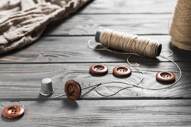 Close-up of sewing item on wooden table Free Photo