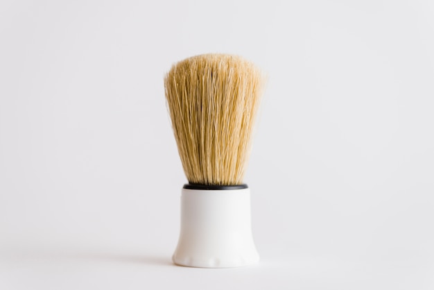 Close-up of shaving brush isolated on white background Free Photo