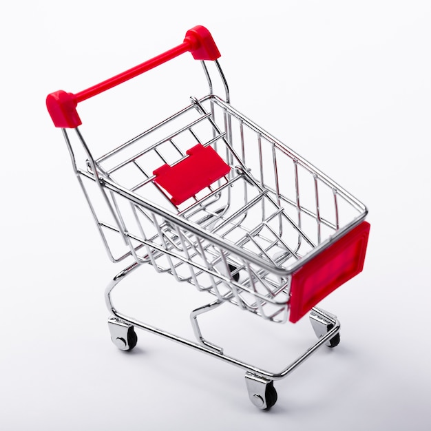Close-up of shopping cart on plain background Free Photo