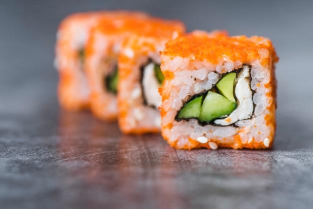 Close-up shot of arranged sushi rolls Free Photo