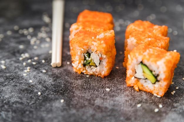 Close-up shot of arranged sushi with sesame seeds Free Photo