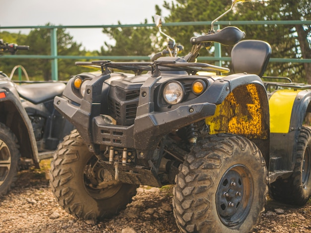 Close up shot of atv 4x4 dirty motor bike outdoors Premium Photo