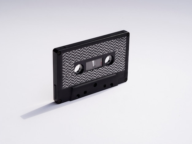 Close-up shot black cassette tape with shadow Free Photo