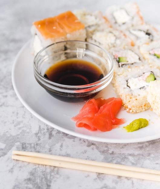 Close up shot full sushi plate Free Photo