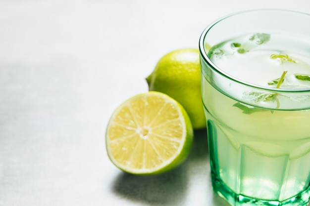 Close up shot of lemonade glass on plain background Free Photo