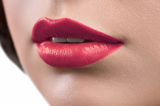 Close up shot of the lips of a woman wearing lipstick or lip glo Premium Photo