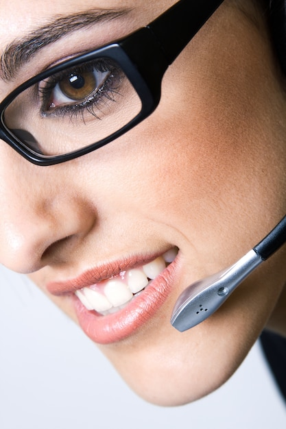 Close up shot of woman with headset Free Photo