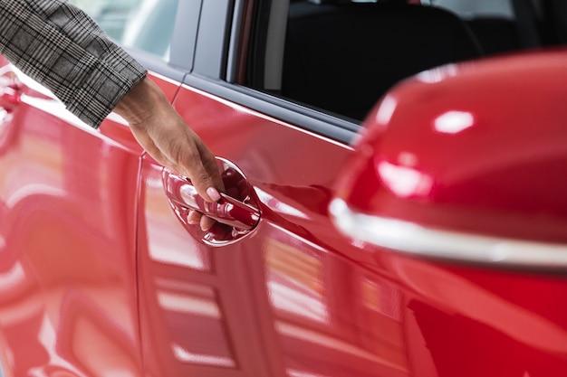Close-up shot of a red car door Free Photo