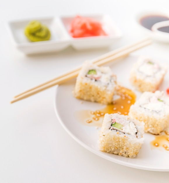 Close up shot of sushi plate with blurred background Free Photo