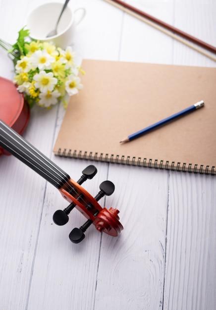 Close-up shot violin headstock orchestra instrumental on white wood Premium Photo