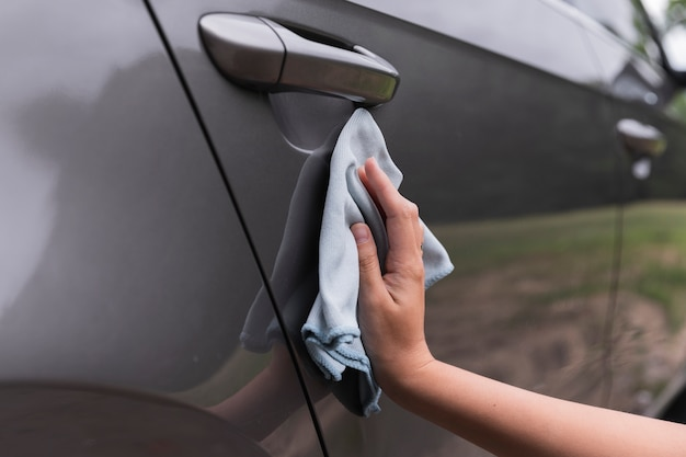 Close-up shot with a hand cleaning the car Free Photo