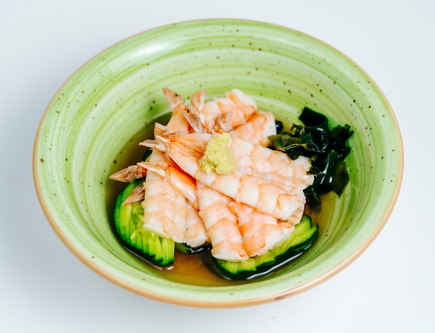 Close up of shrimp miso soup served in apple green bowl in white background Free Photo