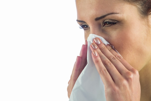 Close-up of sick woman with tissue on mouth Premium Photo