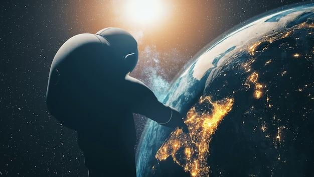 근접 실루엣 우주 비행사 : 태양계의 어두운 별 하늘에서 태양 빛에서 우주 지구 행성 프리미엄 사진