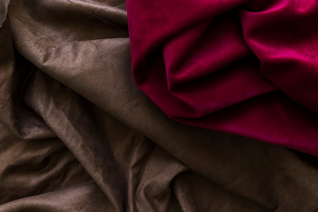 Close-up of silky magenta and brown drapes Free Photo