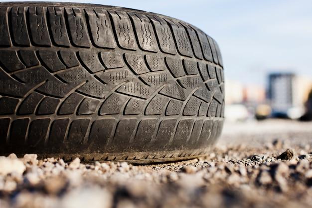 Close up single tire on asphalt Free Photo