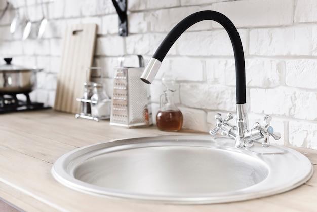 Close-up sink  in modern kitchen Free Photo