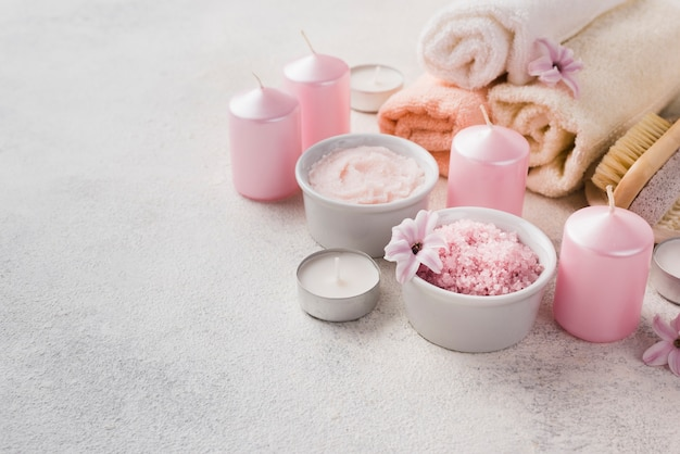 Close-up skincare spa candles with towel Free Photo