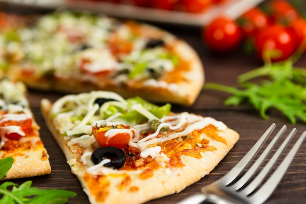 Close-up of slice of pizza Free Photo
