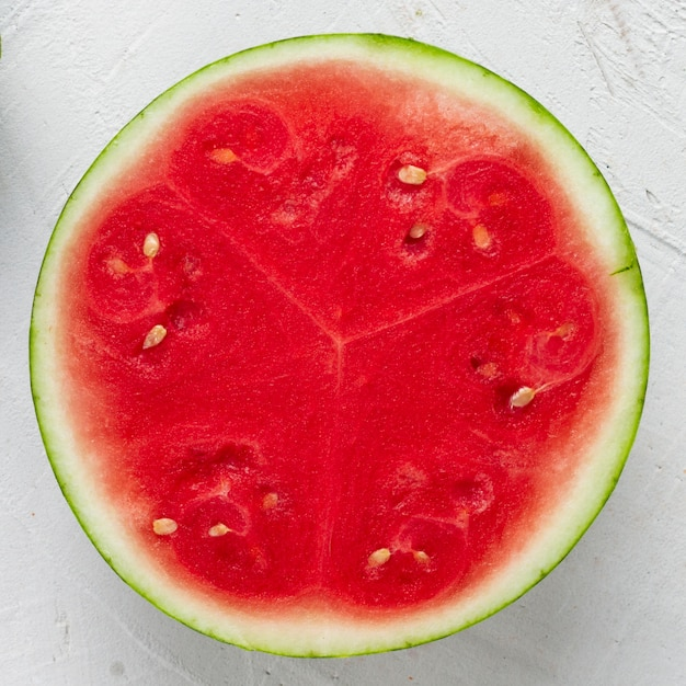 Close-up sliced watermelon with white background Free Photo