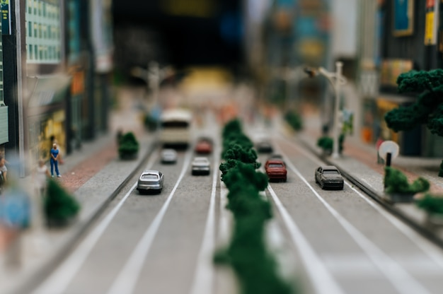 Close up of small cars model on the road, traffic conception. Free Photo