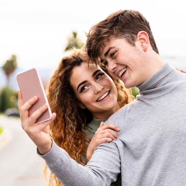 Close-up smiley couple taking selfie Free Photo
