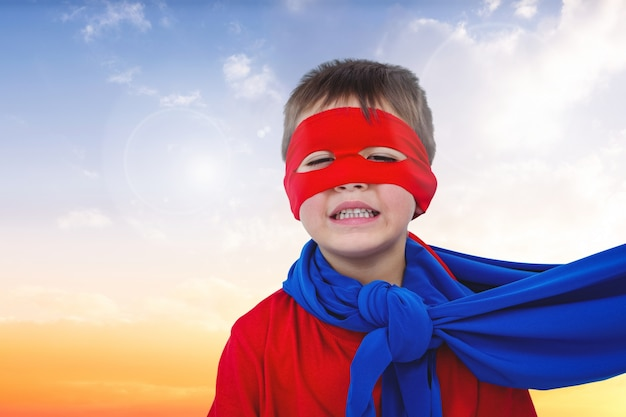 Close-up of smiling boy with red mask Free Photo