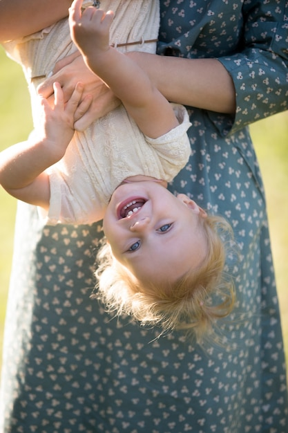 Close-up of smiling girl having fun with her mother Free Photo