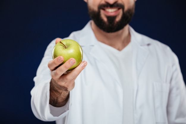 Close up of a smiling male doctor Free Photo