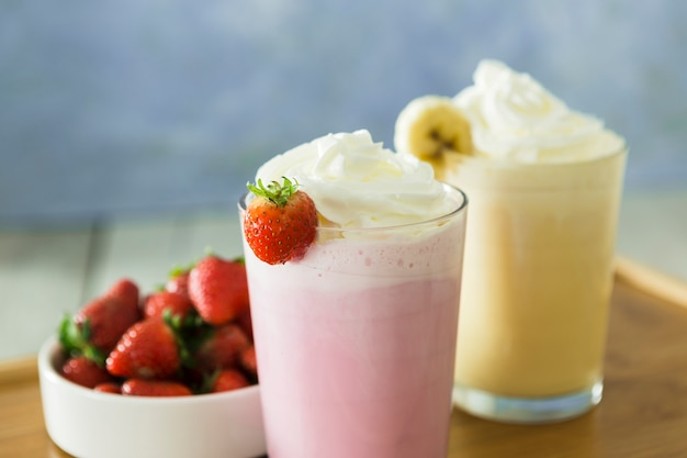 Close-up of smoothies with banana and strawberry Premium Photo