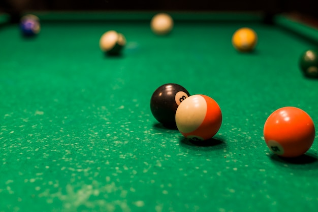 Close-up of snooker balls on snooker table Free Photo