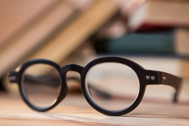 Close-up of spectacles on a table Free Photo