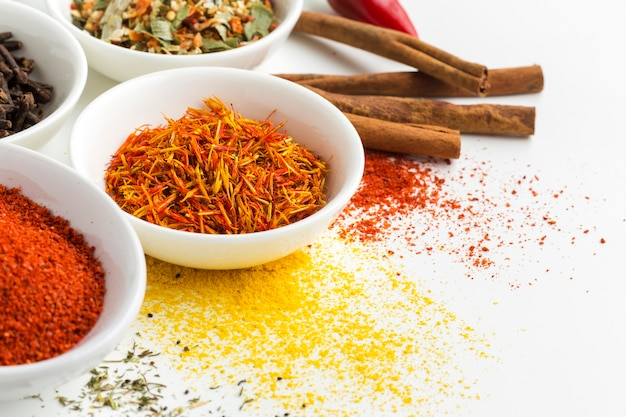 Close-up spice powder and herbs on table Free Photo