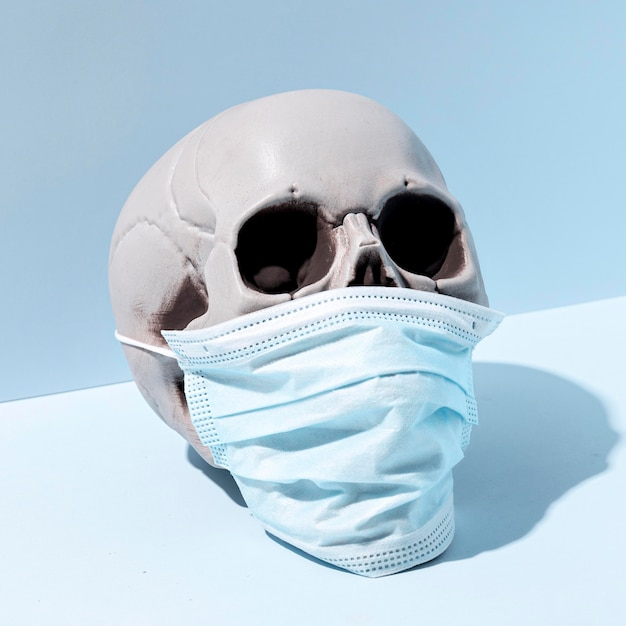 Close-up spooky halloween skull with face mask Free Photo