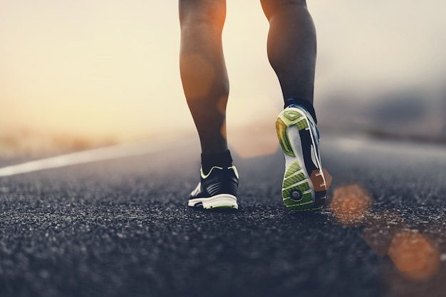 Close up sport shoes of a runner on road for fitness healthy lifestyle. Premium Photo