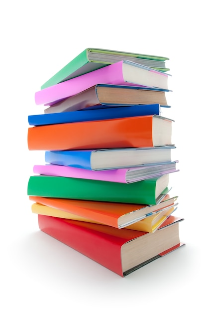 Close up on stack of colorful books isolated Premium Photo